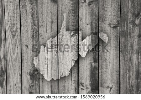 Detailed and colorful image of map of West Virginia on weathered wood #1569020956