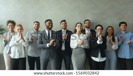 Group of business people clapping hands to congratulate boss, standing ovation after successful meeting #1569032842
