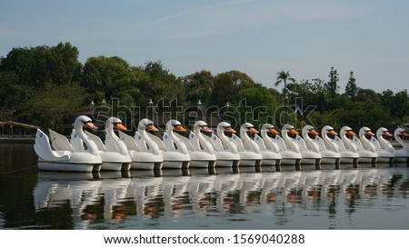 Paddleboats with shape of swans, at Ancol Beach Jakarta Indonesia  #1569040288