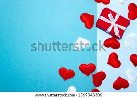 Background for Valentine's day with gifts and hearts. Place for inscription and congratulations on Valentine's Day. Horizontal top view, flat lay. #1569043306