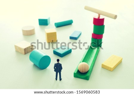Business concept of problem solving and learning strategy. A businessman faces a challenge that needs to be solved in the most efficient way #1569060583