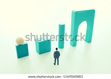 Business concept of problem solving and learning strategy. A businessman faces a challenge that needs to be solved in the most efficient way #1569060883