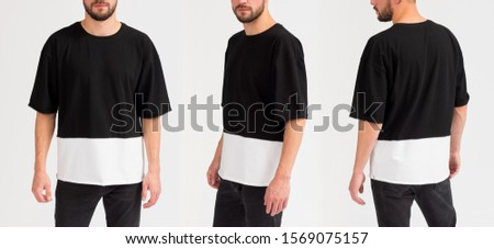 The young man in a black t-shirt on a gray background. Template of a black t-shirt. Front view, side view, rear view #1569075157