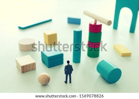 Business concept of problem solving and learning strategy. A businessman faces a challenge that needs to be solved in the most efficient way #1569078826
