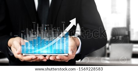 Double Exposure Image of Business and Finance - Businessman with report chart up forward to financial profit growth of stock market investment. #1569228583