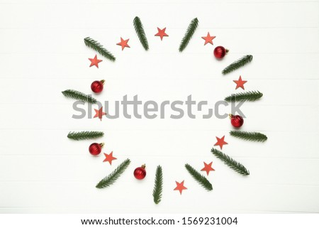 Flat lay christmas composition. Fir tree branches with ornaments on white wooden table #1569231004