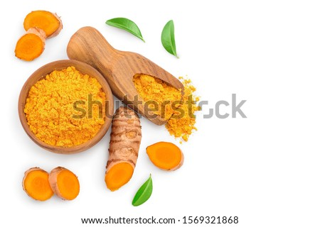 Turmeric powder and turmeric root isolated on white background with copy space for your text. Top view. Flat lay #1569321868