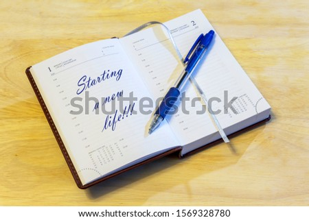 """The diary is open on the first of January page. On the page that says: """"Starting a new life!!!"""". #1569328780"""