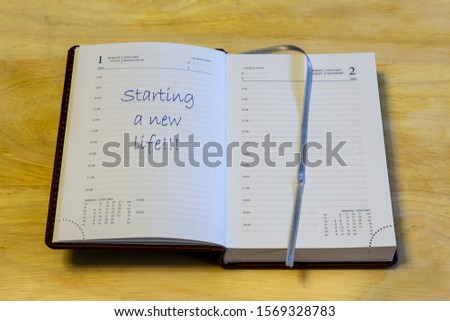 """The diary is open on the first of January page. On the page that says: """"Starting a new life!!!"""". #1569328783"""