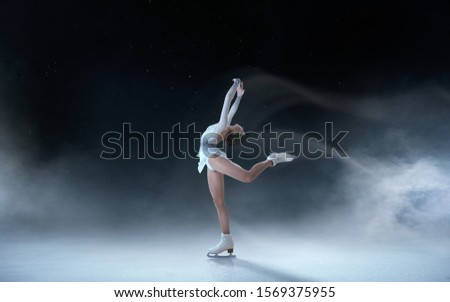 Figure skating girl skating on ice. Royalty-Free Stock Photo #1569375955