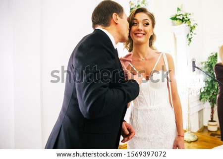 newlyweds in the registry office #1569397072