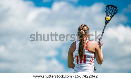 lacrosse woman sky ball blue