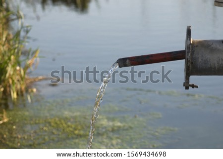 water flows from a metal pipe #1569434698