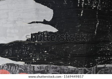 Scratched grungy urban black street poster paper texture, space for text  #1569449857