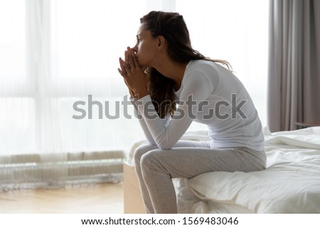 After sleepless night sad woman got up sit on bed thinking, lost in sad thoughts about irreparable mistake decision about abortion, feeling remorse, break up in relations, divorce and jealousy concept #1569483046
