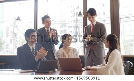 asian businesspeople working in office #1569503911