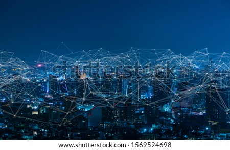 Modern city with wireless network connection and city scape concept.Wireless network and Connection technology concept with city background at night. #1569524698