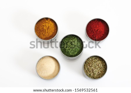 Various kinds of spices in cans #1569532561