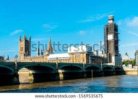 Big Ben and Westminster Bridge with River Thames in London, UK #1569535675