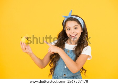 happy child love desserts. Delicious cupcakes. Gluten free recipe. Homemade muffin. Happy childhood. Kid girl hold glazed muffins. Cafe restaurant food. vintage girl muffin yellow background. #1569537478