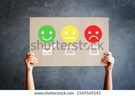 Woman hand showing select happy on satisfaction evaluation in cardboard #1569569245