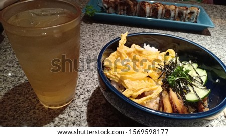 a Japanese dish with egg and vegetable dishes on top #1569598177