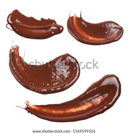 Liquid chocolate stroke in the form of an arc. Set of chocolate strokes. Dessert presentation. Chocolate sauce, ganache, gravy. Top view photo isolated on a white background. #1569599326
