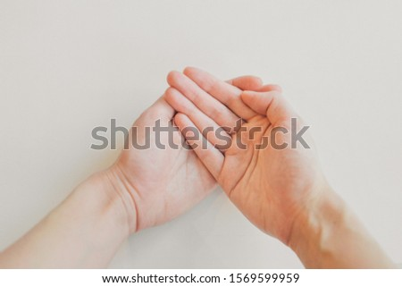 hands on white background. the concept of manifestation of emotions, gestures: petition, prayer #1569599959