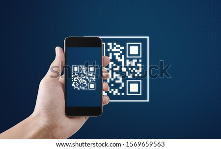 QR code scanning payment and verification. Hand using mobile smart phone scan QR code #1569659563