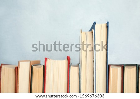 Collection of old books on light background #1569676303