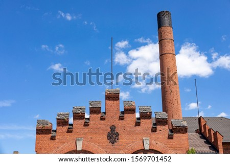 Old factory with a brick chimney #1569701452