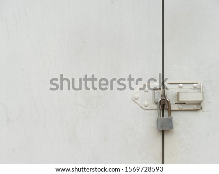 a mechanical device for securing a door or receptacle so that it cannot be opened except by a key or by a series of manipulations that can be carried out only by a person knowing the secret or code. #1569728593