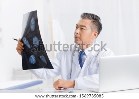 The doctor see x-rays - one person #1569735085