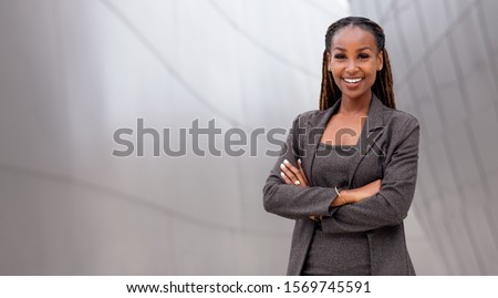 African American businesswoman leader, boss, CEO, financial corporate advisor in full wide banner  Royalty-Free Stock Photo #1569745591