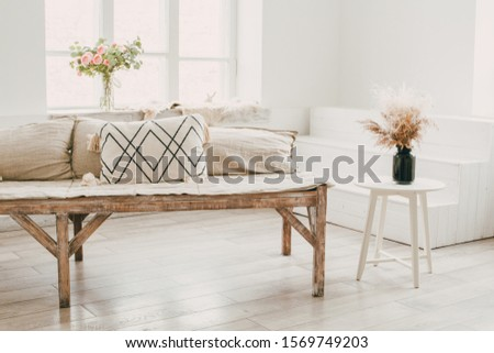 Scandinavian minimalist student room design with natural wood furniture and cotton pillows, a white table  #1569749203