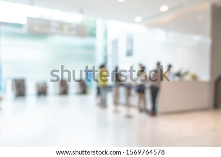 Medical blur background customer reception or patient service counter, office lobby in hospital clinic, or bank business building blurry interior inside waiting hall area  #1569764578