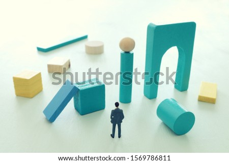 Business concept of problem solving and learning strategy. A businessman faces a challenge that needs to be solved in the most efficient way #1569786811