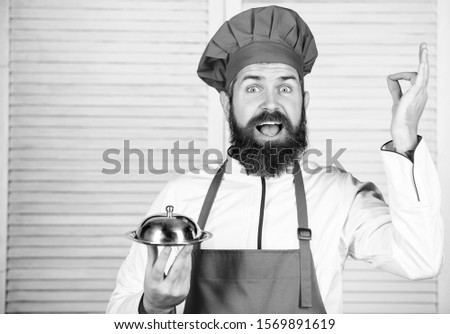 serve food. Cuisine culinary. man holds kitchen dish tray in restaurant. Healthy food cooking. Mature hipster with beard. Dieting organic food. Happy bearded man. chef recipe. Best best best. #1569891619