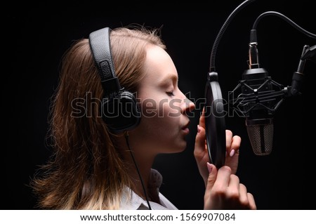 Singer, blogger, voice acting. Work in the studio with a studio microphone #1569907084
