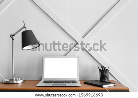 Modern stylish workplace with laptop in office #1569916693