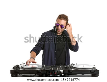Male dj playing music on white background Royalty-Free Stock Photo #1569916774