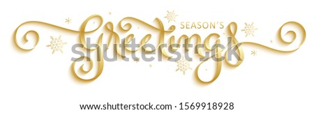 SEASON'S GREETINGS vector brush calligraphy with flourishes and snowflakes Royalty-Free Stock Photo #1569918928