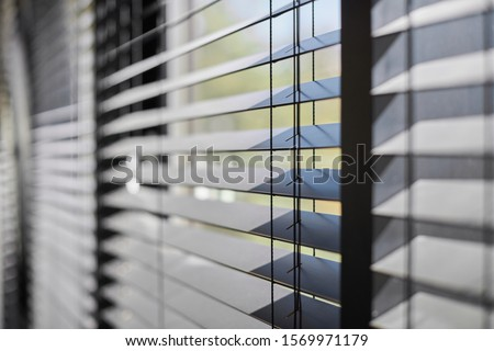 Office blinds. Modern wooden jalousie. Office meeting room lighting range control. Royalty-Free Stock Photo #1569971179