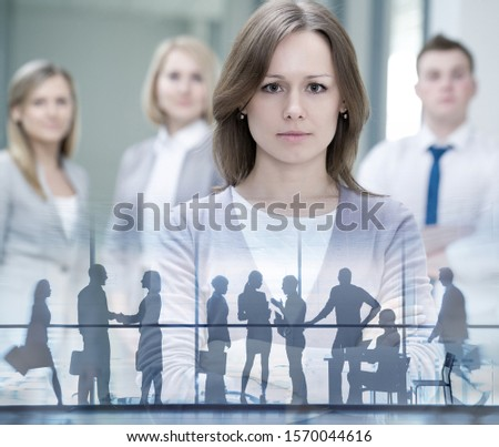 Group of successful  businesspeople on the background silhouette buse people. #1570044616