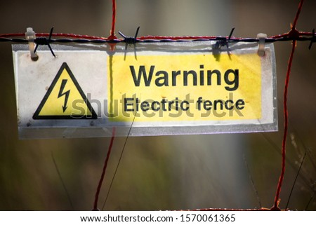 An electric fence warning sign