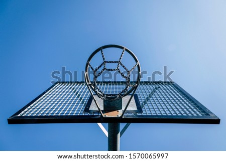 basketball basket from below with blue sky, no people and no ball, space for text #1570065997