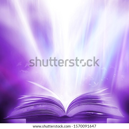 Imagine a picture book of an ancient book opened on a wooden table with a sparkling golden background. With magical power, magic, lightning around a glowing glowing book In the room of darkness #1570091647
