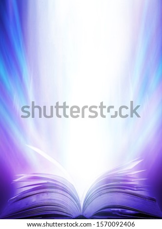 An ancient book that opens with magic, the magic light in the darkness on the wooden table, by the bright light shining down as the power to search for knowledge, religion and background #1570092406