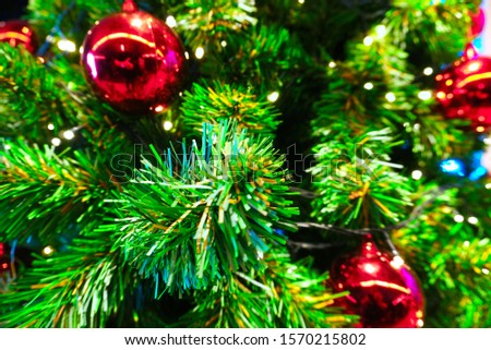 Christmas tree decorate with red glossy ball #1570215802