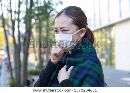 japanese woman wears white mask #1570234651